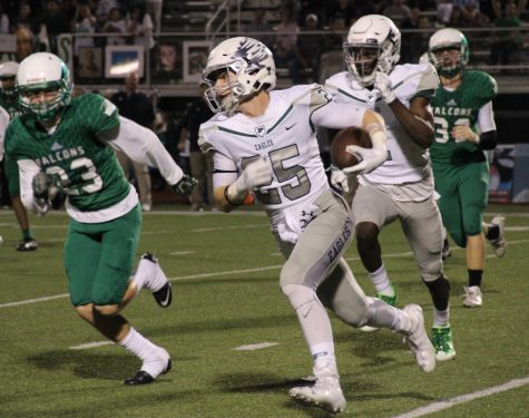 Running back Cody Gallegos rushes to the right against Lake Dallas.