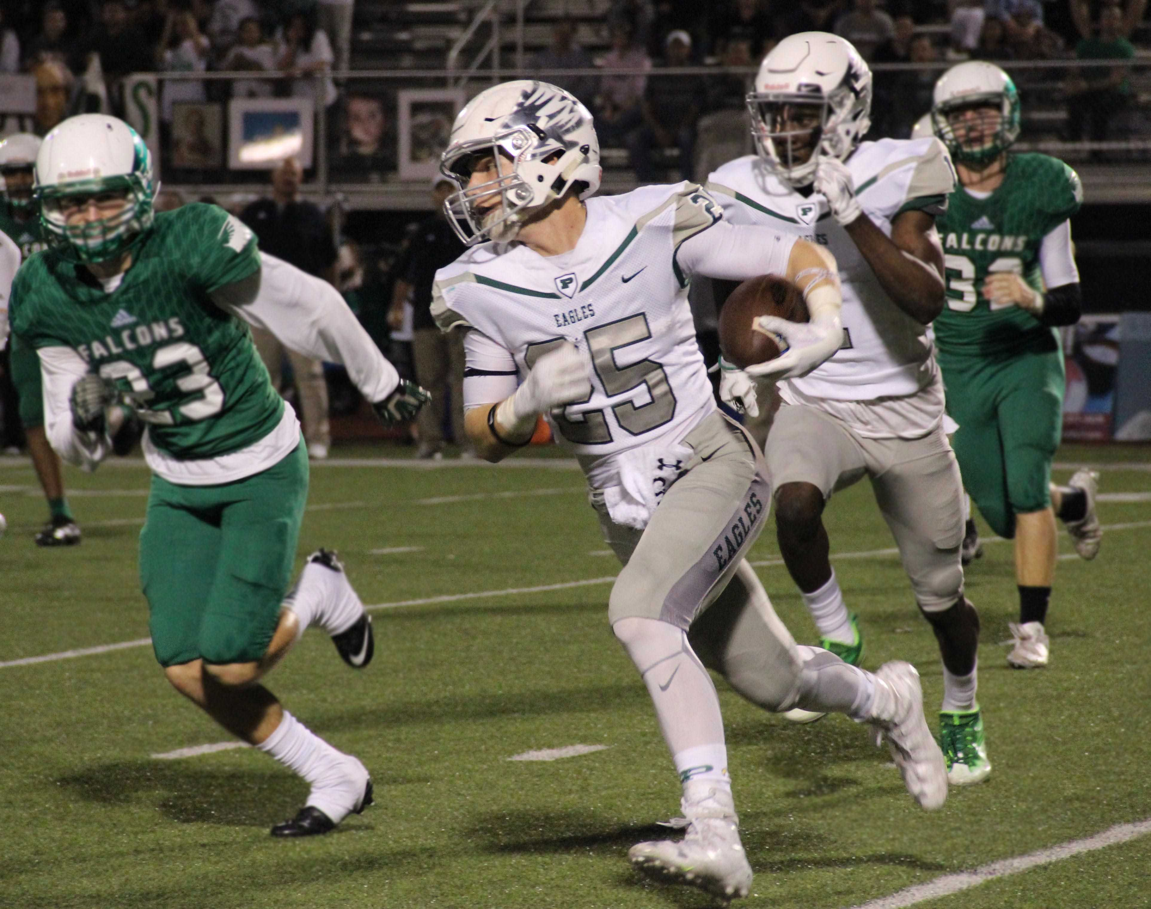 Cody Gallegos runs the ball against Lake Dallas in the Eagles only district loss of the season.
