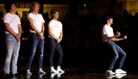 Blackout pep rally lights up arena
