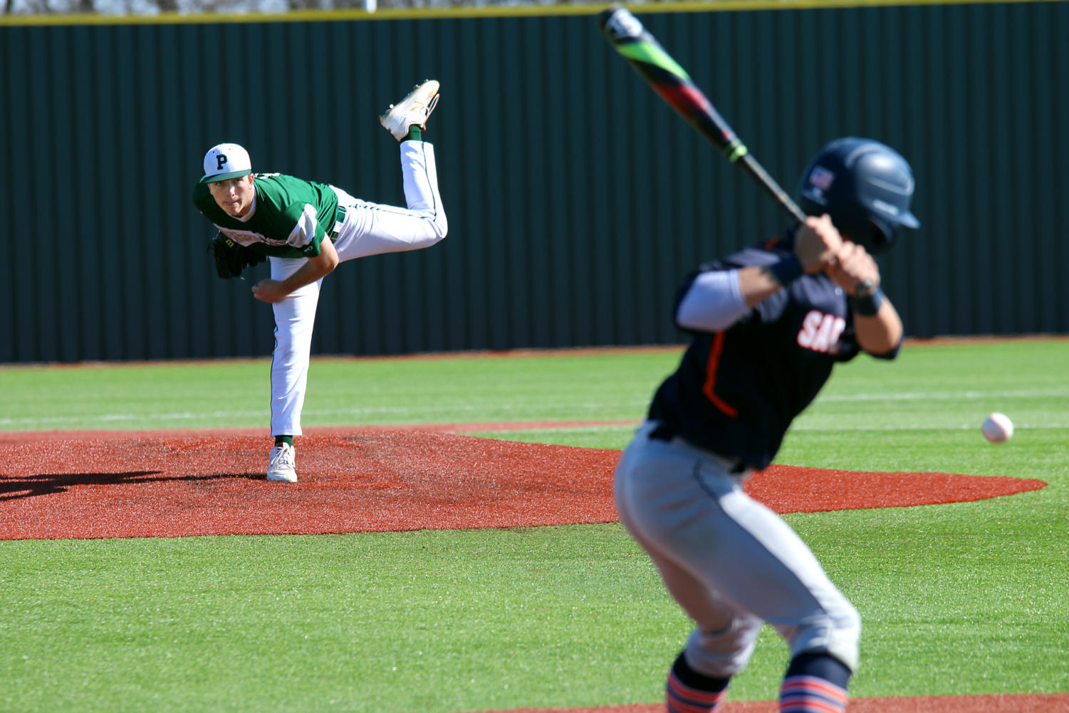 Senior Picher Conner Jackson throws a pitch during a game against Sachse in a preseason tournament.