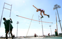 Vaulting to the top at home track meet
