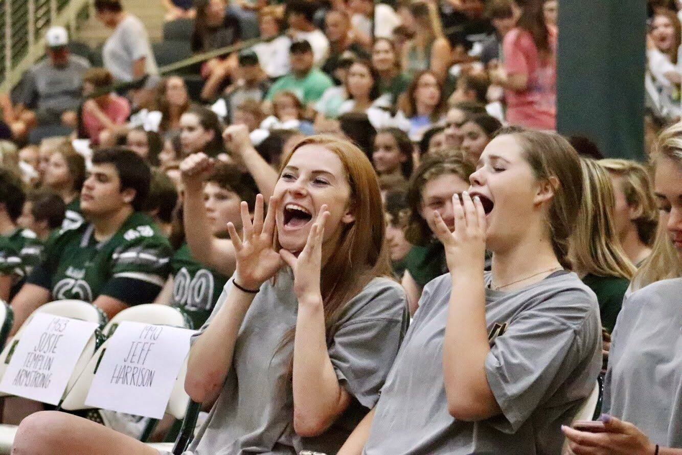 Varsity volleyball players Kayla Martin and Kylie Motes cheer at the community pep rally. Then, they and their teammates went on to defeat the No. 3-ranked team of Plano East by a score of 3-1. That home match-up occurred Friday evening at 5:30.