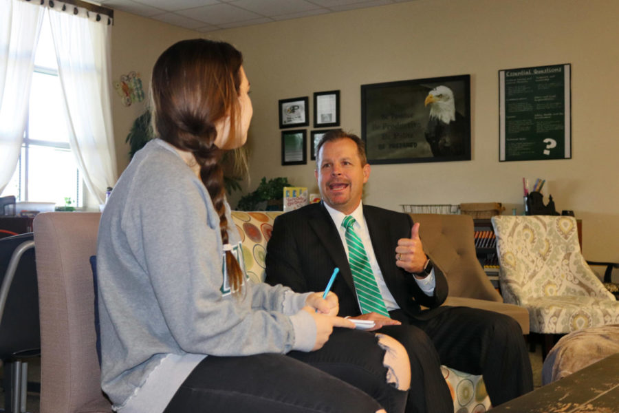 """In an Eagle Time interview on Thursday, Aug. 30, Katie Johnson asks superintendent Dr. Drew Watkins to provide tips for students on how to avoid traffic issues. One of his tips included leaving earlier  to get to school. """"We're at Capacity,"""" Dr. Watkins said. """"I encourage students to start earlier. Give yourself adequate time, and everybody needs to assume people won't always follow the traffic laws."""""""
