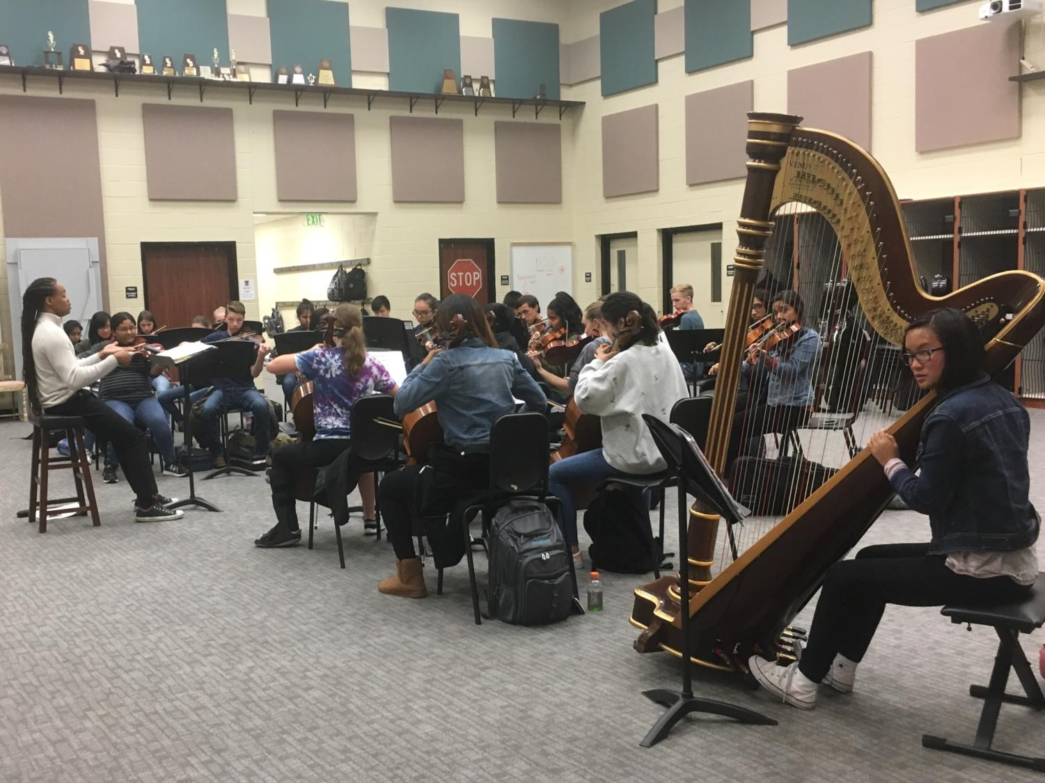 The orchestra members practice Wednesday for their upcoming concert on Oct. 18 at 6:30 p.m. in the high school auditorium. Student musicians Alejandra Maldonado and Warren Tseng advanced at the Region 24 All-Region auditions.