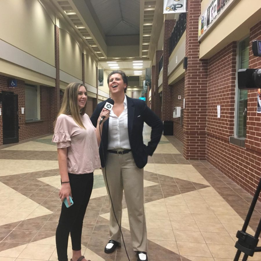 ENN+reporter+Haylee+Brown+interviews+democratic+candidate+Lorie+Burch+after+the+Town+Hall+Forum.+Burch+answered+student-written+questions+during+the+forum+and+had+a+table+set+up+outside+the+auditorium+before+and+after+for+questions.+%E2%80%9CWhen+I+was+a+student+at+Plano+Senior+High+in+AP+history+class+and+in+government%2C+I+never+imagined+that+one+day+I+would+aspire+to+be+a+part+of+that%2C%E2%80%9D+Burch+said.+%E2%80%9CBut+my+teachers+really+inspired+me+to+get+involved+in+advocacy+and+leadership.%E2%80%9D