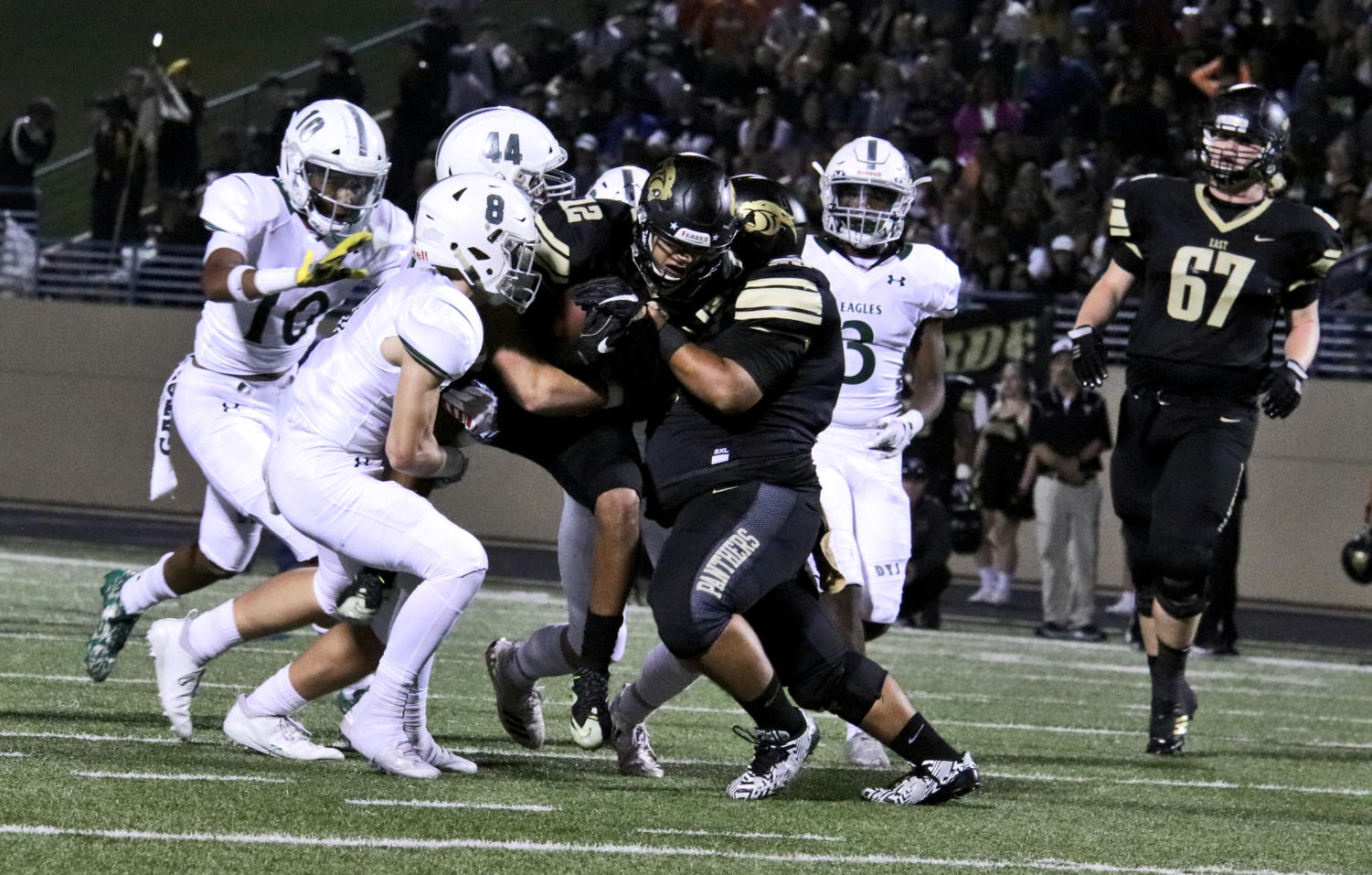 Prosper's defense looks to bring down Plano East wide receiver Braylon Henderson, No. 12. Henderson tallied 153 yards and one touchdown. His performance helped Plano Easy past Prosper 26-14.