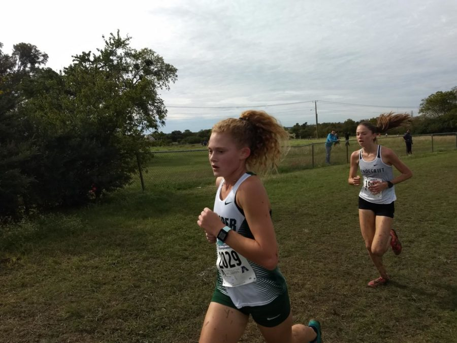 Varsity+cross+country+runner+Aubrey+O%27Connell+heads+for+the+finish+line+in+the+regional+cross+country+meet+on+Monday%2C+Oct.+22.+O%27Connell+placed+second+out+of+183+runners+in+this+race%2C+which+was+held+at+the+Jesse+Owens+Memorial+Athletic+Complex+in+Dallas.+The+entire+girls%27+team+qualified+for+the+state+meet.+%22O%E2%80%99Connell+led+the+way+for+the+Lady+Eagles%2C%22+Coach+Jennifer+Gegogeine+said.+%22Her+finish+also+earned+her+all-region+honors.%22+O%27Connell+finished+with+a+time+of++17+minutes+for+the+5K+and+reset+her+previous+school+record.%22+According+to+Gegogeine%2C+other+contributors+to+the+team%27s+success+include+Alexis+Svoboda%2C+eighth%2C+and+Tatum+Castillo%2C+ninth.+Both+Svoboda+and+Castillo+also+received+all-region+honors.+Sadie+Gonzales+finished+19th%2C+Madi+Chisty++45th+%2C+Emily+Kern+104th%2C++and+Kirstin+Towle+took+118th.+They+all+run+again+in+Round+Rock+on+Nov.+3+for+the+state+title.