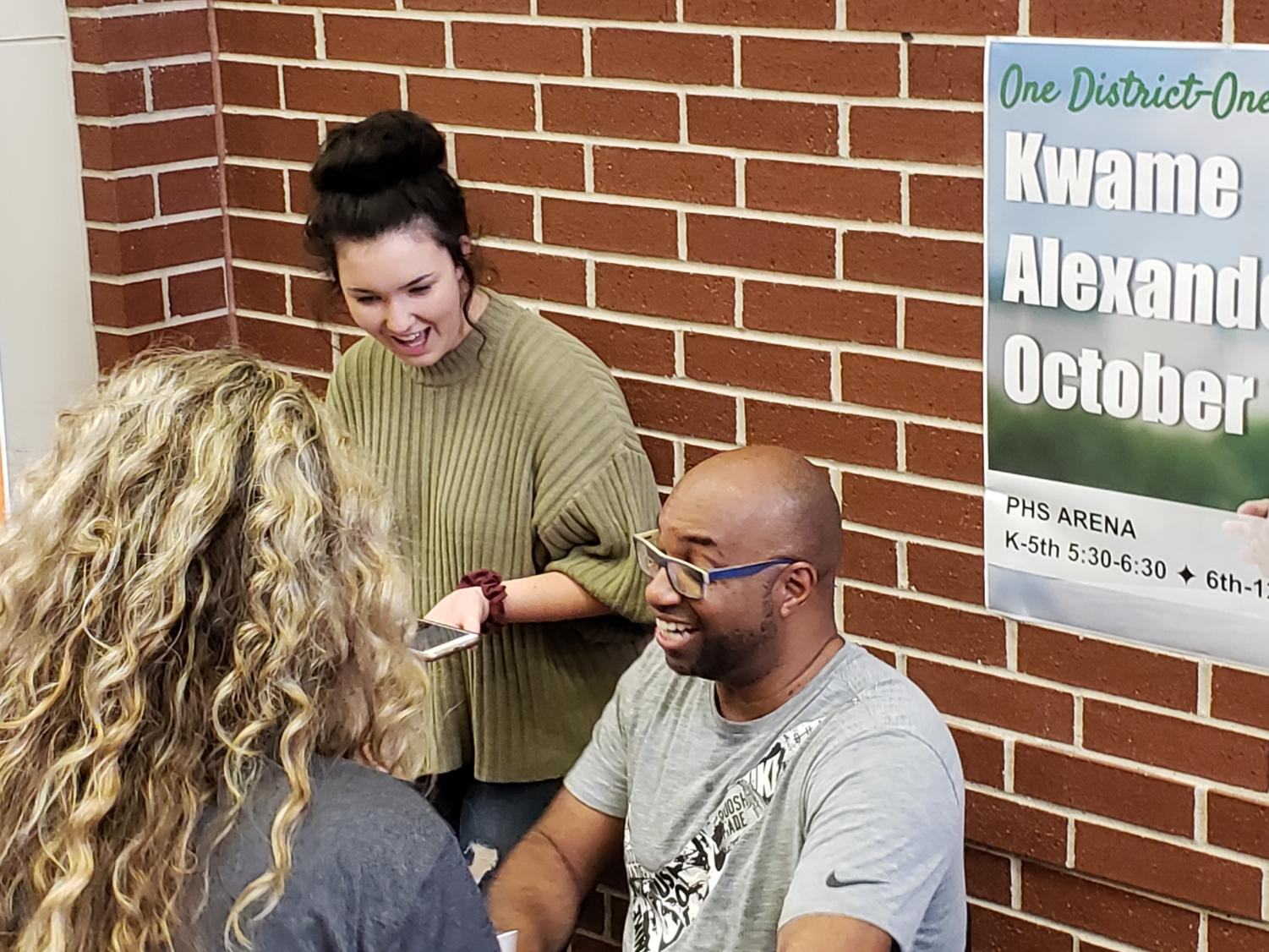 "ENO Assistant Editor Haley Stack interviews guest author Kwame Alexander as he signs books outside the high school arena. This event, which accompanied the 'One District, One Read' program, was Monday, Oct. 1 and sponsored by Prosper ISD librarians. Alexander has written books appealing to readers on different age levels. ""I want to inspire young people,"" Alexander said. ""I think young people are going to be the ones to inspire a better world, and I want to help them do that to make the world a better place."""