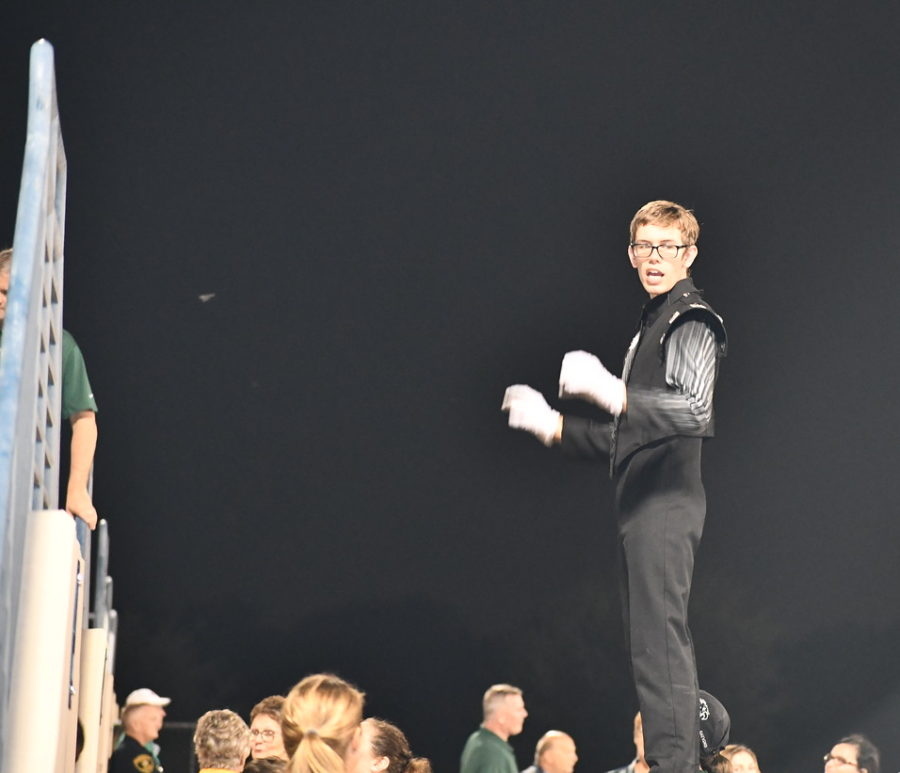 Senior+William+Lewis+leads++%22The+Mighty+Eagle+Band%22+at+a+football+game+on+Sept.+28.+His+second+year+at+Prosper%2C+Lewis+moved+up+to+drum+major+this+year.+Drum+major+is+the+highest+ranking+student+position+in+marching+band.+%E2%80%9CWill+is+the+first+male+drum+major+that+we%E2%80%99ve+had+in+five+years%2C%E2%80%9D+band+director+John+Alstrin+said.+%E2%80%9CI+think+that%E2%80%99s+good+for+the+band+to+have+both+boy+and+girl+leaders+so+that+they+learn+that+it%E2%80%99s+more+like+a+family%2C+and+we+all+play+a+part.%E2%80%9D
