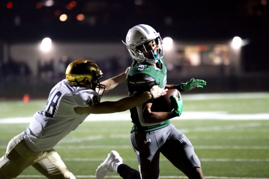 Prosper+senior+Devin+Haskins%2C+No.+5%2C+avoids+a+Jesuit+Ranger+defender.+Haskins+had+23+receiving+yards+and+a+touchdown+Friday.+The+Eagles+escaped+Jesuit+with+a+30-28+win.
