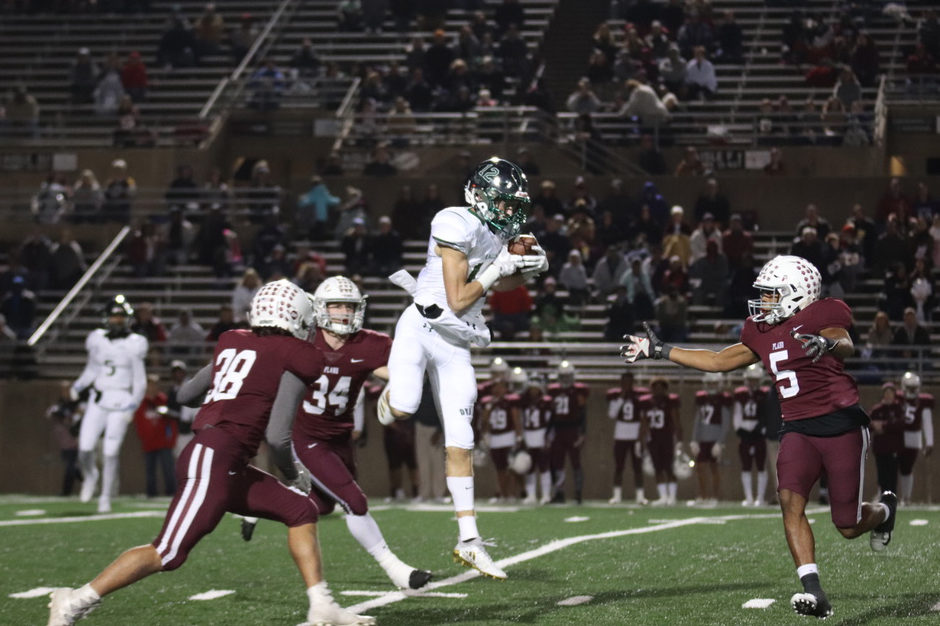 Junior Hayden Metcalf makes a leaping catch over multiple Plano defenders. Metcalf finished with four receptions for 69 yards in Prosper's 43-35 win. This win knocked Plano out of the playoff race.