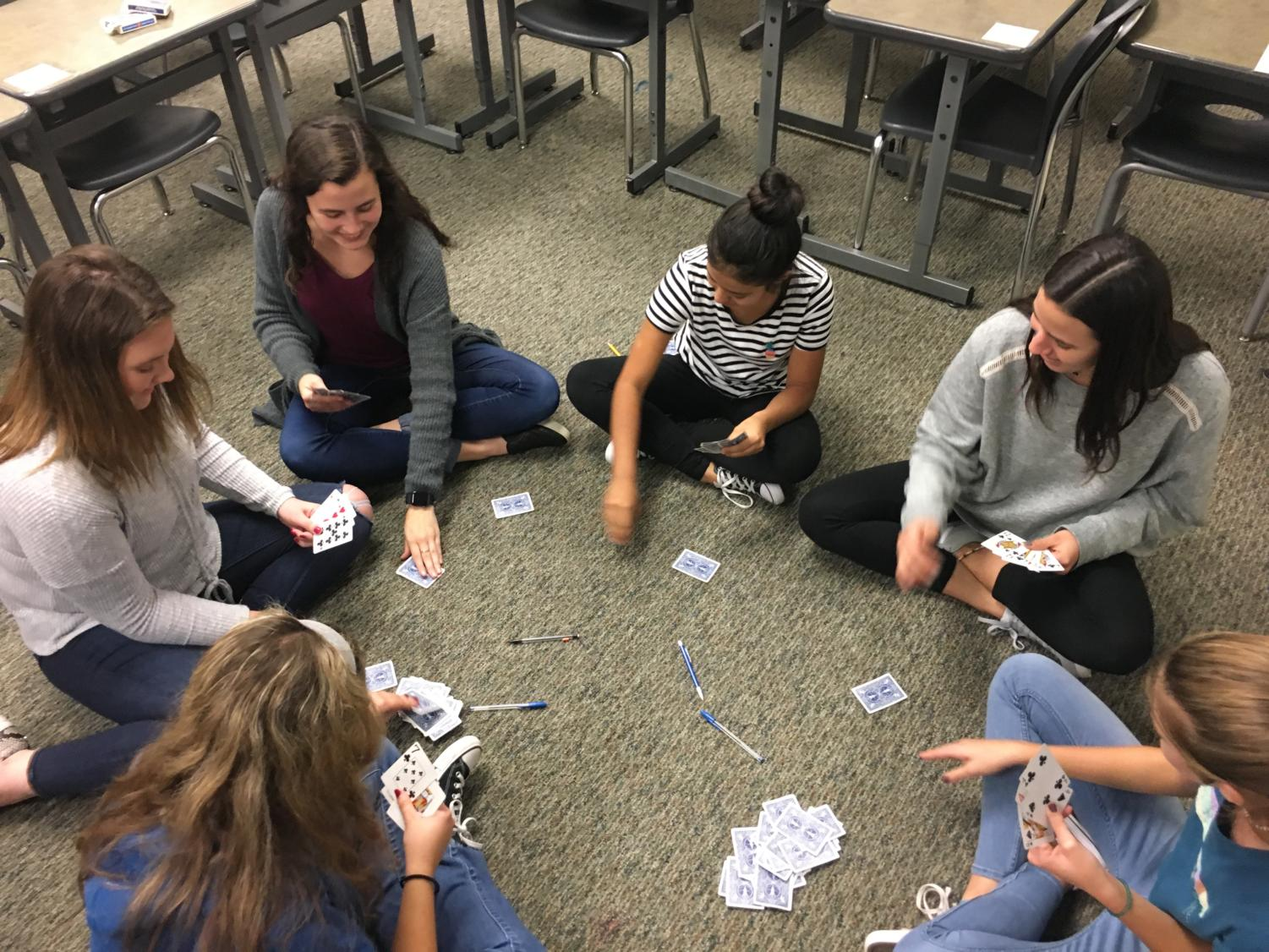 "Catholic Student Association members Emily Witmeyer, Carmen Mijares, Karolina Rubio-Terrazas, Sofi Mijares, Sophia Boughton and Madison Medeiros play ""Spoons"" at their last meeting Thursday, Nov. 8. The CSA meets the second and last Thursday of every month. ""It's a really good time to just bond with everyone,"" senior Emily Witmeyer said. ""I love it. It feels like home there."""