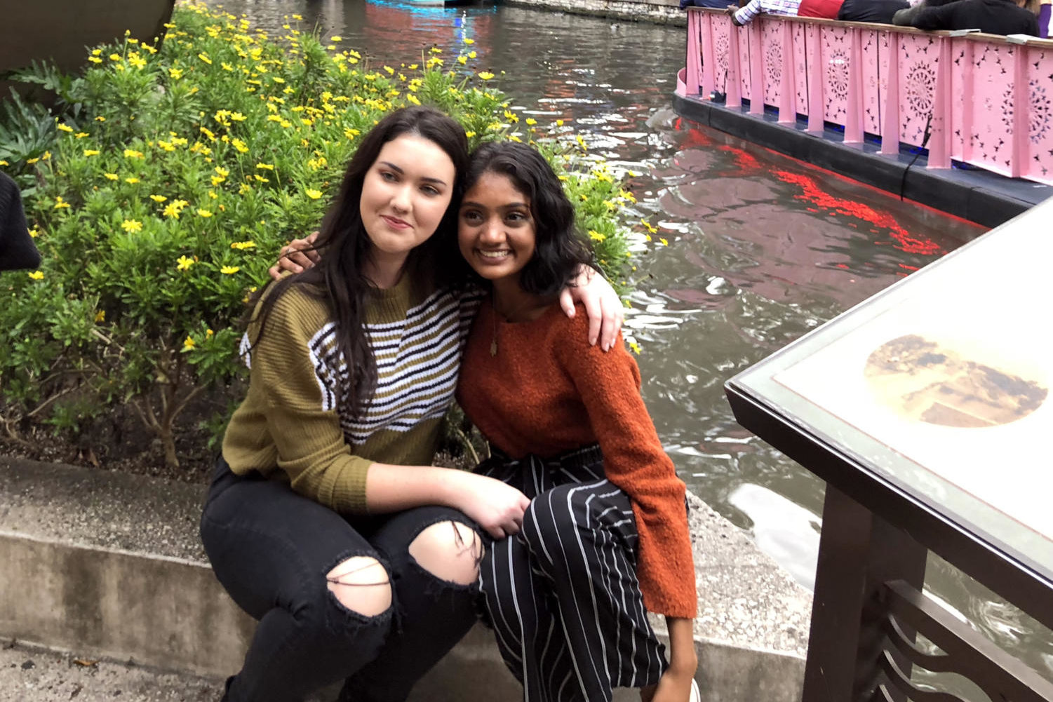 "Junior Haley Stack and senior Neha Madhira take a break alongside the River Walk in San Antonio during the Texas Association of Journalism Educators Association's state convention held in San Antonio in October. The two journalists led a workshop there on student press rights and recently received a national award from the Women's Media Center for their work in that area. ""It's important to remember the power of your voice and how much speaking out and standing up can impact not only your life, but everyone's around you,"" Madhira said. ""As student journalists, all of our stories are thoroughly researched and so when we do that, we are providing (readers) with accurate resources."""