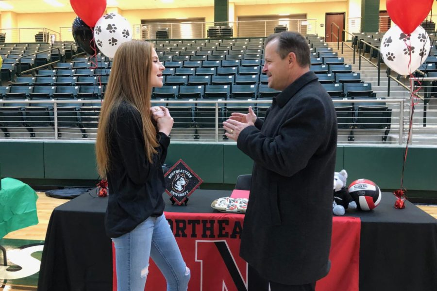 While Prosper volleyball may have left the playoff race last week, Kayla Martin, discusses her next games with superintendent Drew Watkins during the Wednesday, Nov. 14, signing party.  Martin,   a volleyball standout, signed to continue playing her sport with Northeastern University in Boston, Mass., when she goes to college next year.  She is one of 14 athletes who took their college commitments public and attended the early morning signing party.
