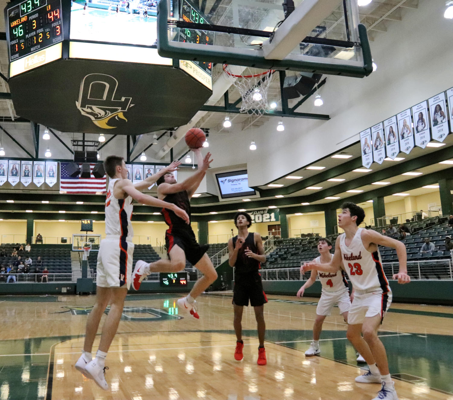 A Frisco Wakeland player tries to block Lake Highlands' shot. They played in this year's Sewell Prosper ISD Tournament Friday, Nov. 30. Lake Highland won against Wakeland, 62-60.