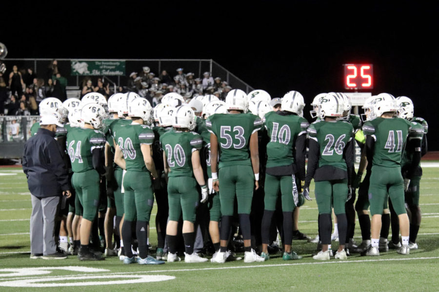 The+Eagles+gather+during+a+time+out+as+coach+Brandon+Schmidt+talks+to+them.+The+Eagles+beat+the++Naaman+Forest+Rangers+48-14+in+the+first+round+of+playoffs.+Prosper+will+play+Longview+High+school+on+Saturday%2C+Nov.+24%2C+at+7+p.m.+at+The+Star+in+Frisco.