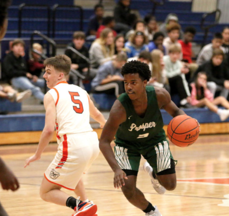 Prosper+played+McKinney+North+in+the+first+game+of+the+season+on+Nov.+13.+Grant+Shaw%2C+No.+2%2C+takes+the+ball%2C+around++McKinney+North+defender+Jake+Jurak%2C+No.+5.+The++Eagles+were+unable+to+defeat+the+Bulldogs+in+their+first+game.+Prosper+will+play+their+first+tournament+of+the+season+Nov.+19-20+at+Lone+Star+High+School+in+Frisco.+