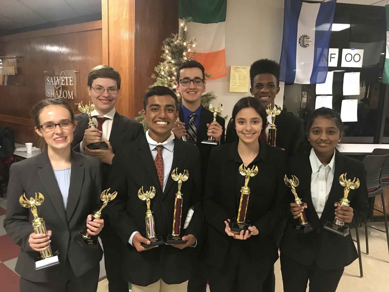 The Debate team holds their awards earned Nov. 30-Dec. 12. For full details on who won what continue reading this edition of the