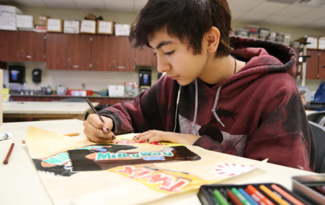 Zinnia Aguilar works on her project for art class. Students can join art club, but do not need to be enrolled in an art class during school.