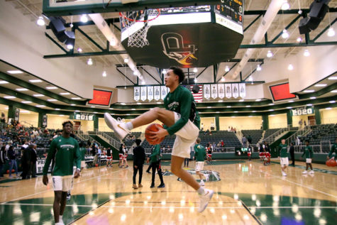 Senior Josh Davis, No. 11, warms-up before a game last season. Davis recently hit the 1,000-point mark in a game against Marcus High School Dec. 4.