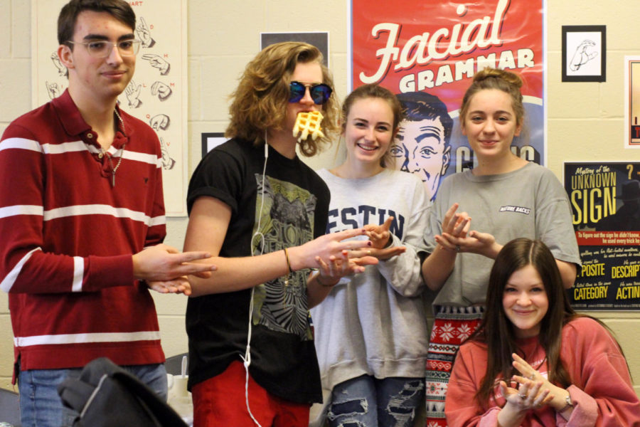 Miles Crabtree, Noah Paape, Stacey Fechner, Rebecca Henry, and Abby Milstein sign
