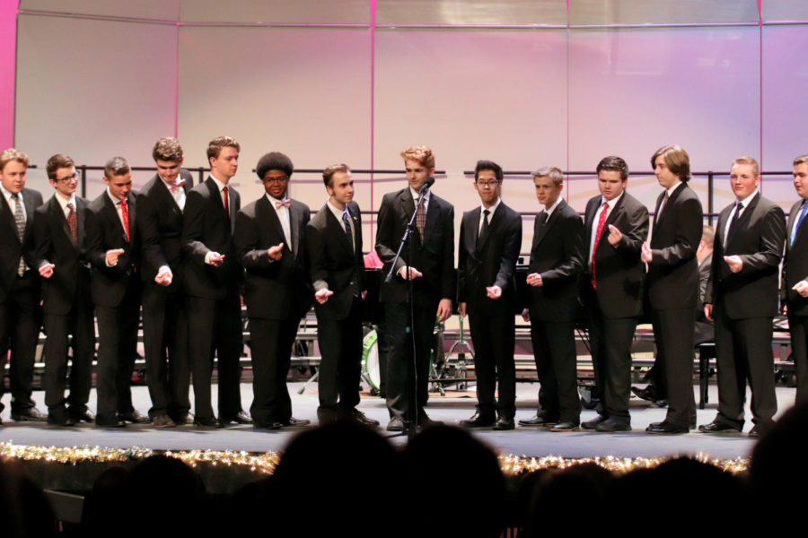 The men of the Varsity Mixed Choir snap to White Christmas. at last years winter concert. The soloists at the middle are Jacen Miserak, Carson Hackworth and Marcus Chu. I thought it just a fun piece for the guys where we could just put out our energy, Hackworth said.