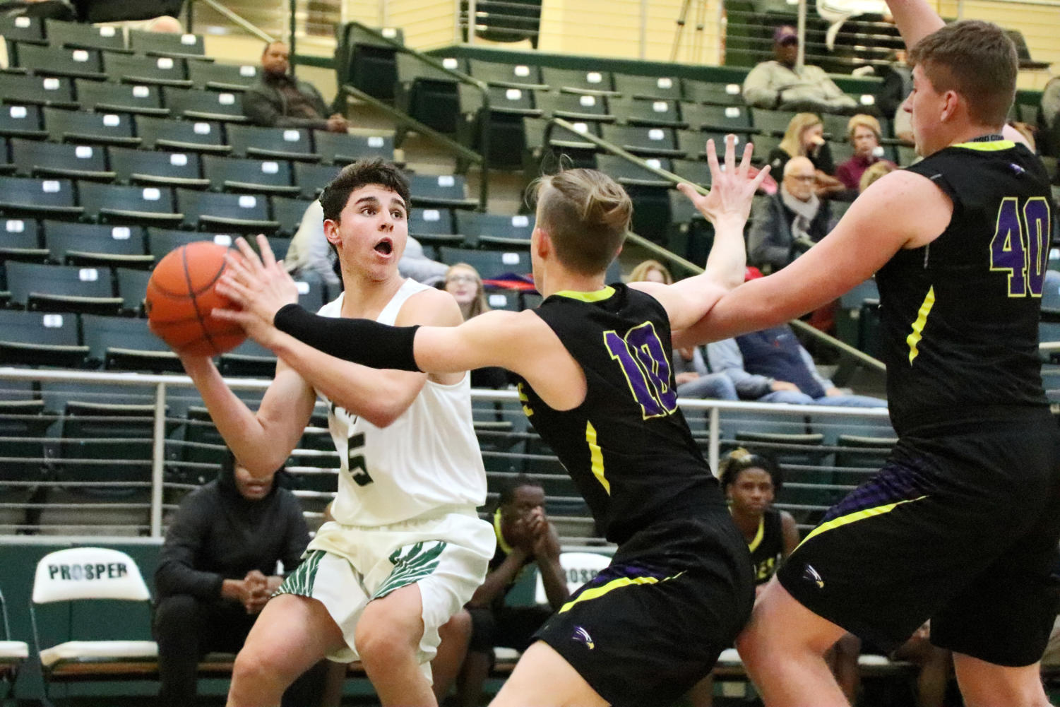 Sophomore Amman Allan, No. 5, looks to make a basket as Richardson's defender Aaaron Heft, No. 10, tries to block  him. They played Friday, Dec. 7, at home. The Eagles lost to Richardson 63-48.