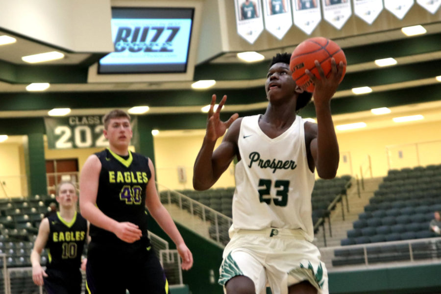 Kin Toliver, No. 23, looks to make a basket during their game against the Richardson Eagles. They played Friday, Dec. 7 at home. They came up short in a loss, 63-48. In this analysis piece, sports writer Zach Markey says