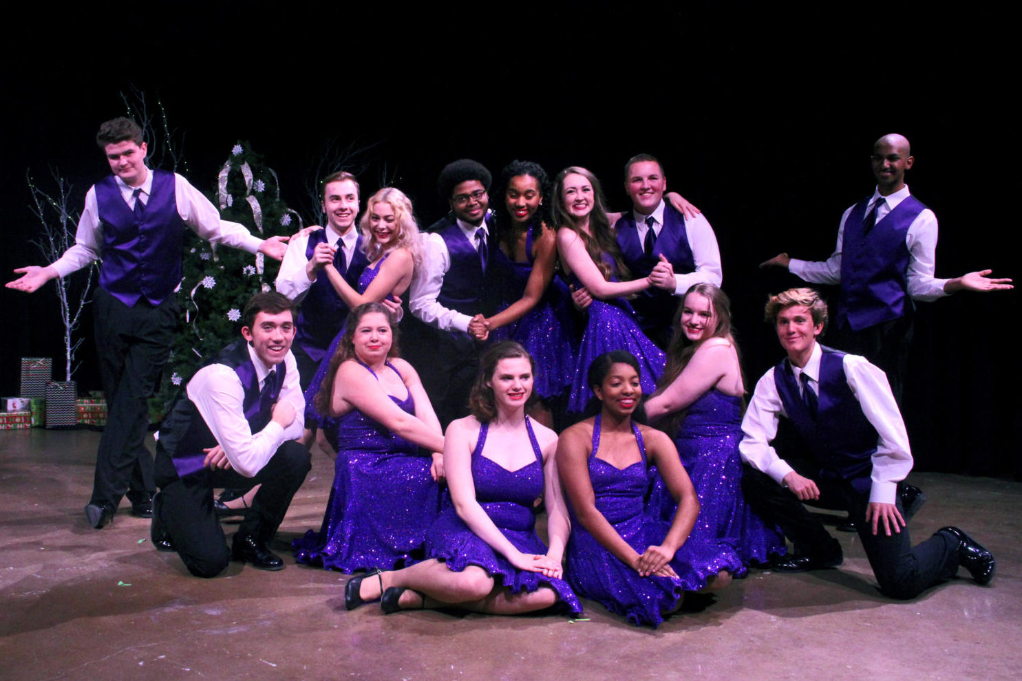 Show Choir poses together after the final song of their performance on Dec. 7. The group sang and danced to a variety of holiday songs.