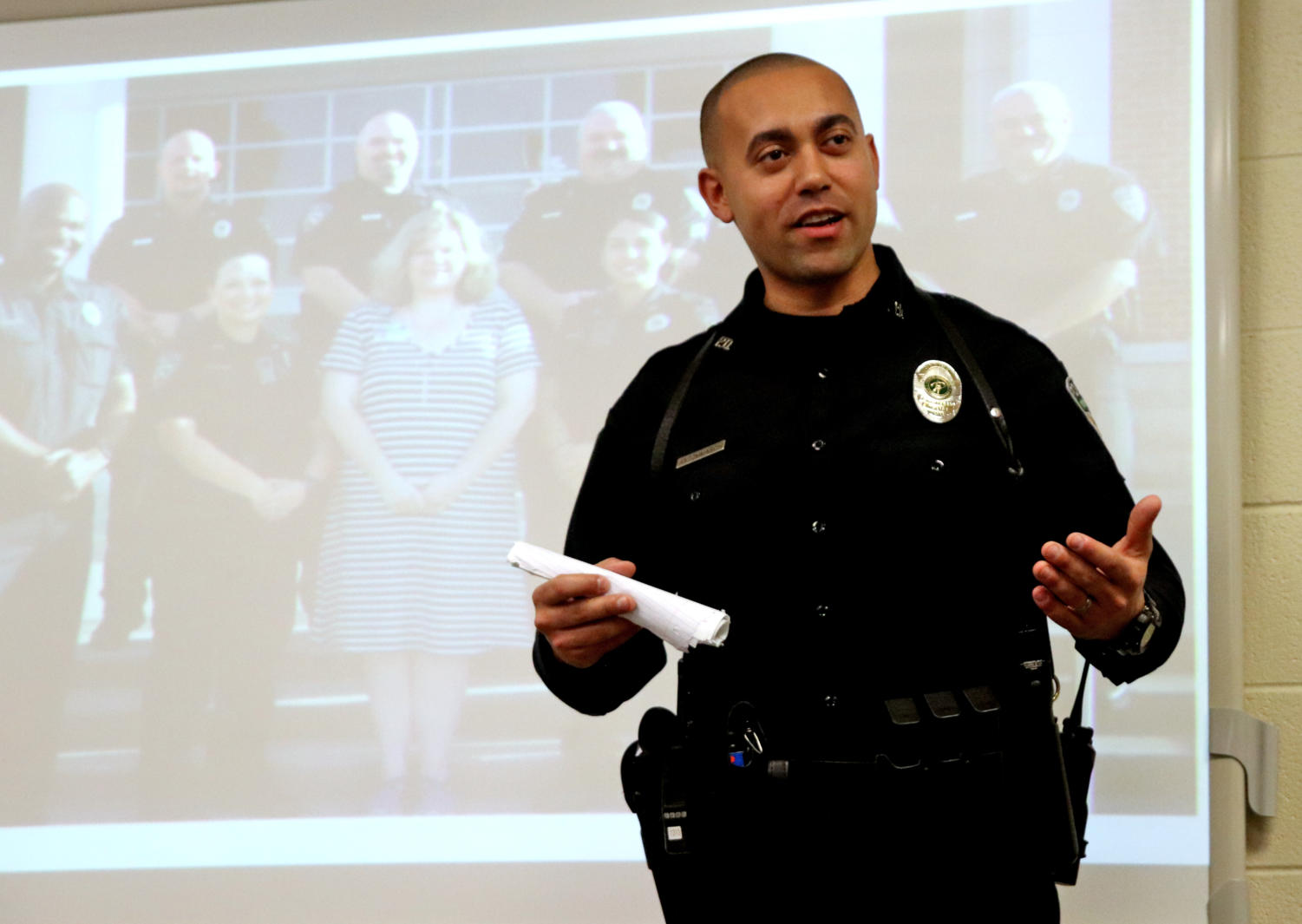 Officer Steve Antonmarchi informs instructor Rod McCall's government class about police procedures.