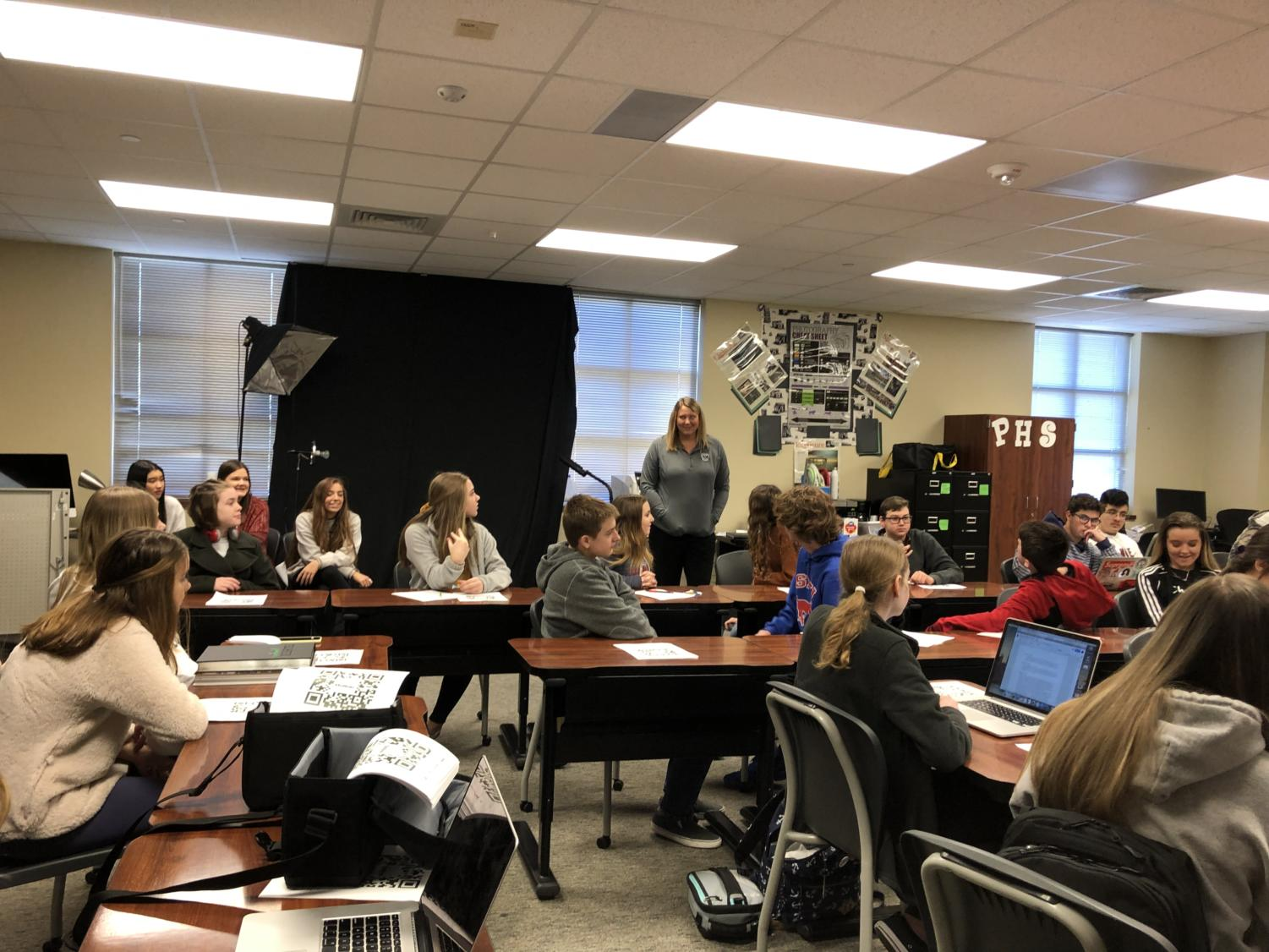 Eighth-graders from Reynolds Middle School attend a Journalism I class as they listen to yearbook adviser and photojournalism instructor Lyndsey Hamlin speak about opportunities available to students next year. These students toured  campus on Jan. 23. The Rogers students came on Jan. 24. They are given the opportunity to sit in on classes and learn about different electives offered at Prosper.