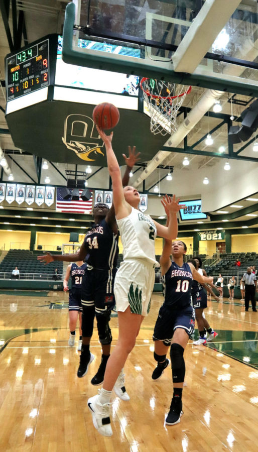 Senior+Madie+Bunker+attempts+to+tip+the+ball+in+the+first+quarter.+Bunker+scored+2+points+in+the+game.+McKinney+Boyd+players+Anija+Simmons+%28left%29+and+Symmone+James+%28right%29+surround+Bunker+on+both+sides.