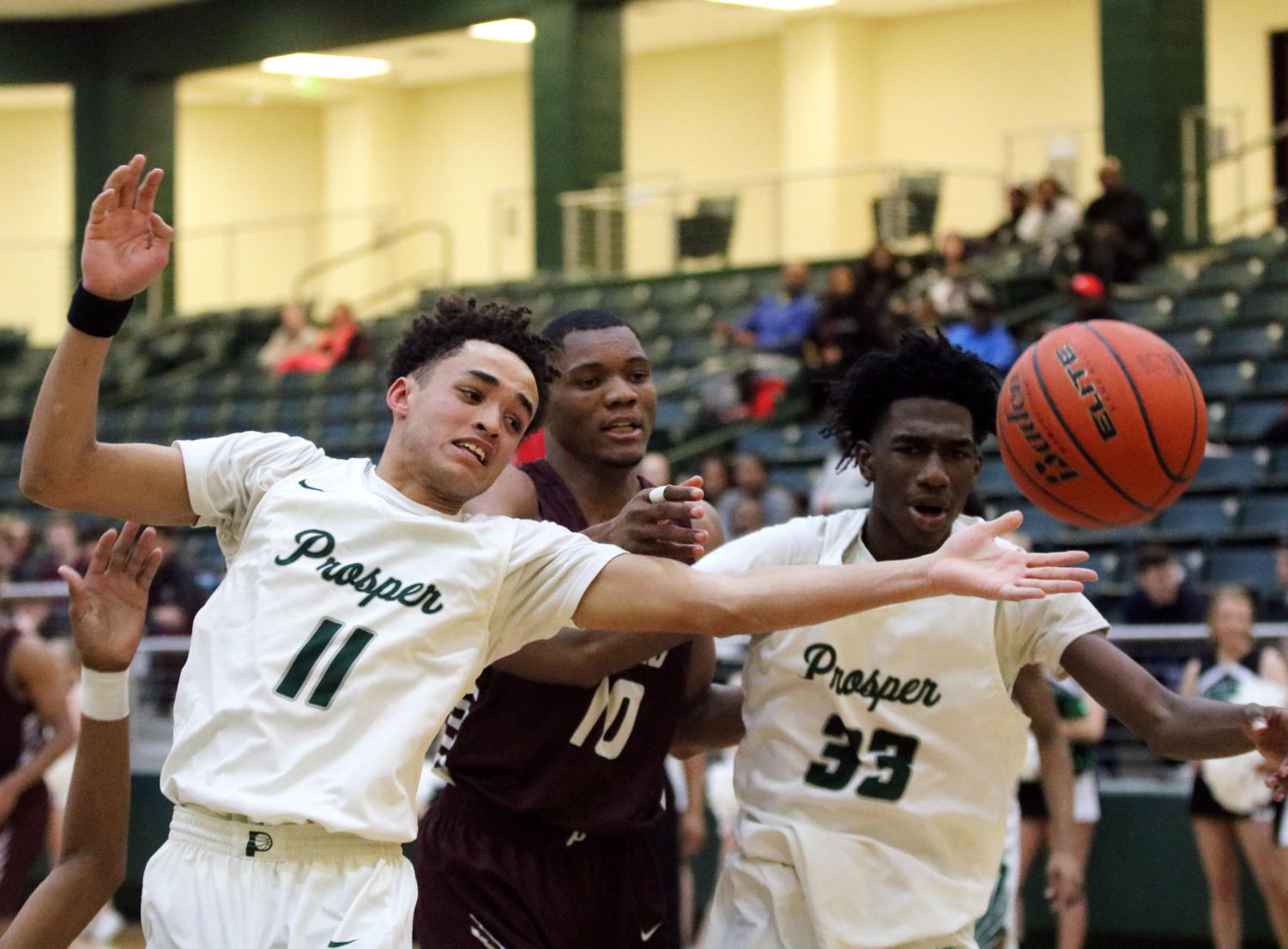 Senior Josh Davis, No. 11, and Sophomore Luke Chancey, No. 33, block the ball from Plano Senior opponent Senior Stanley Joseph,  No. 10, in  the center. Both Eagles' efforts helped Prosper win 57-53. Prosper will face off against McKinney High and Plano East this week.