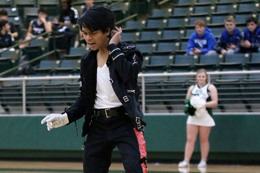 Junior Keane Wijeratne performs his Michael Jackson impersonation at the basketball game Jan. 30. Wijeratne won the 2017 talent show with 'King of Pop' routine.