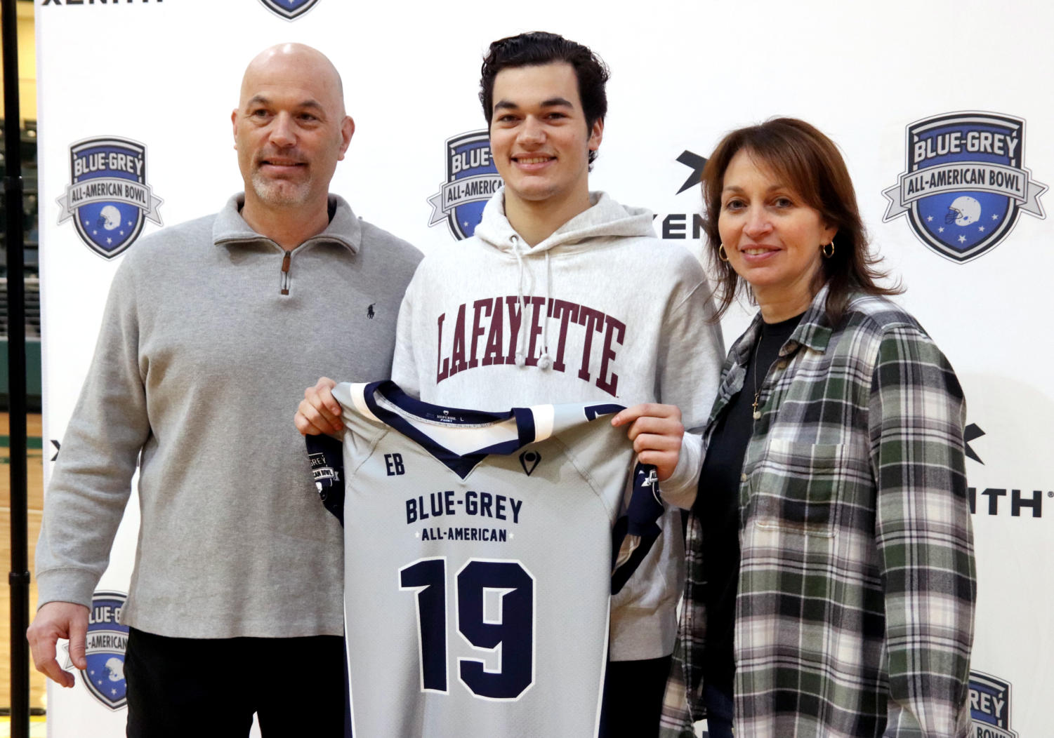 Keegan Shoemaker stands alongside his parents as he receives his All-American jersey. Shoemaker committed to Lafayette college earlier this year. Shoemaker led the football team to nine wins in his senior season at quarterback.