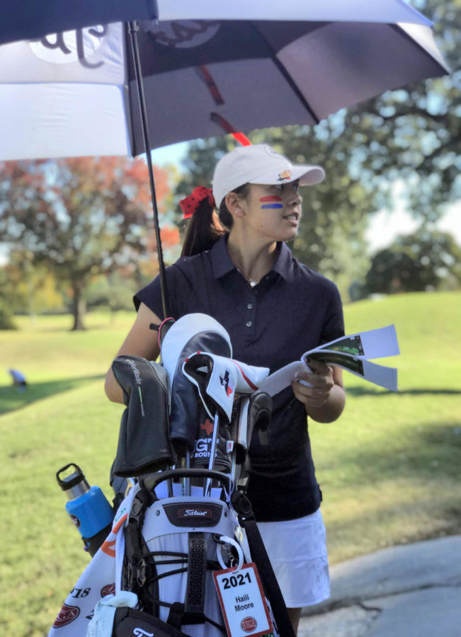 Sophomore Haili Moore prepares for her golf tournament. She competed in the Florida Harder Hall tournament, Jan. 9-12.