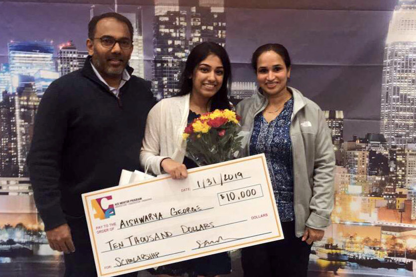 "Senior Arya George stands with her parents after winning a $10,000 scholarship. ""I did not think I would win,"" George said. ""They had six scholarships in total. There was one $1,000, four $5,000, and then the $10,000 scholarship. They called the $10,000, and said it was me. I freaked out. It was a dream."" The scholarships were given out at the ACE awards, which was a 15 week mentorship based program."