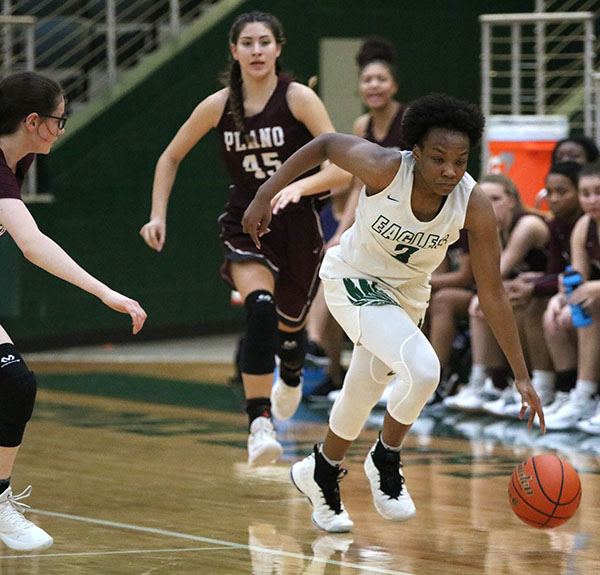 Senior Jordan Oliver, No. 3, steals the ball in a defensive play against Plano Senior High School. Oliver finished the game with 25 points. Her efforts helped the Lady Eagles win 63-62 against Plano.