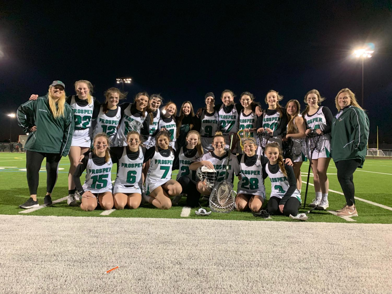 The Prosper Girl's Lacrosse team won their first game of the season Monday, Feb. 25. The Eagle's beat Ursuline 9-3, with 6 goals from sophomore Angie Ruiz. They will play next tomorrow, Feb. 28 against Rockwall.   Left to right top row:  Assistant Coach Tiffany Seabright, Jacey Oxner, Logan Hulvey, Julia Solt, Lauren Womack, Kalyn Ponders, Kadence Wahnschaffe, Taylor Sweet, Ella Dellenbach, Merritt Bauss, Nola Richardson, Alex Pavolonis, Kamryn Jones, head coach Heather Freeland   Left to right bottom row:  Lily Evans, Izzy Evans, Angie Ruiz, Camden Silvestri, Hope Rasberry, Mallory Griffiths, Amandalynn Garst
