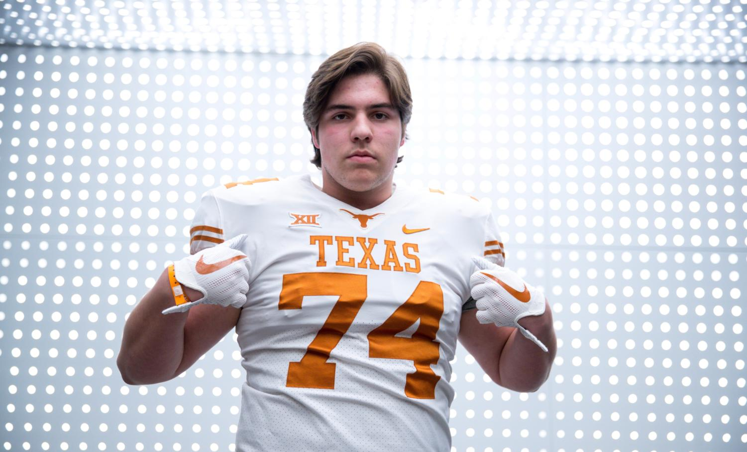 "Offensive tackle Jake Majors puts on a University of Texas jersey. He committed to play football on Jan. 24. ""UT was calling my name,"" Majors said. ""In my heart, I knew I wanted to stay in Texas and be a Longhorn."""