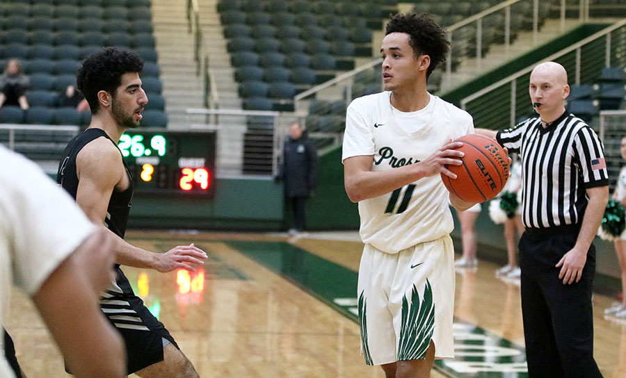 Josh Davis looks for an open teammate in a game against the Plano West Wolves. As Prosper's season comes to an end, Davis, who is a senior, will be leaving the team.