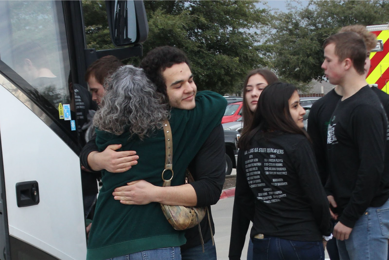 "Junior varsity wrestler Josiah Squires hugs his mom, Dalana Squires, goodbye as he leaves for the state championship. The tournament will take place at Cypress, Texas, in the Berry Center. ""Last year was my first year here, and it was also our last year at 5A,"" coach Sion King said. ""Our kids were adjusting to being one of the better teams at 5A and now we jumped another level."""