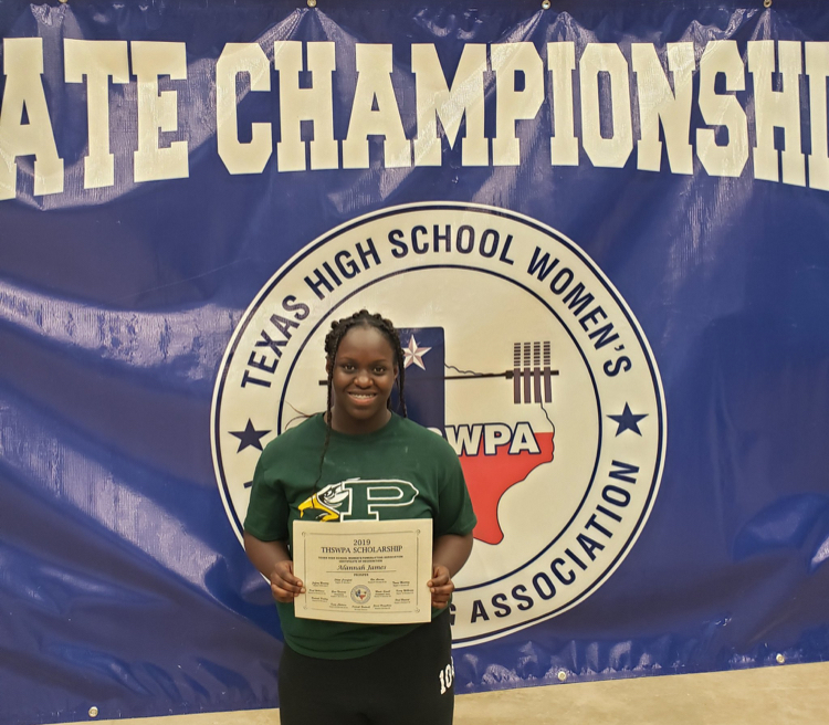 PHS+powerlifter+Alannah+James+holds+up+her+Region+6+Scholarship.+The+Texas+High+School+Women%E2%80%99s+Powerlifting+Association+presented+the+award.+James+placed+third+in+state+for+6A+at+the+THSWPA+Championship.