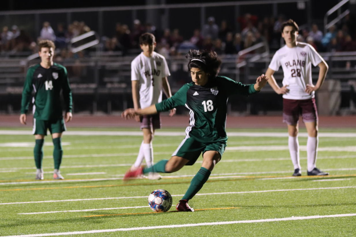 Junior Osbaldo Loredo shoots a penalty kick against Plano on Friday night. The boys lost 3-2, which dropped them to fourth in district. They play Rowlett on Thursday,  March 28.