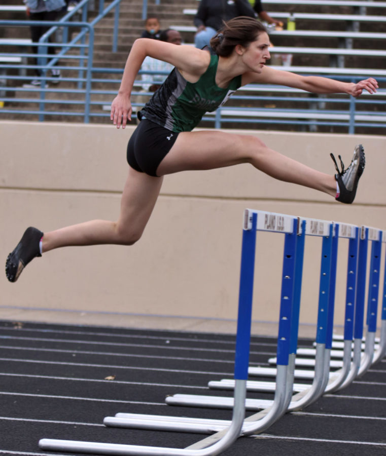 Competitor+Haley+Huck+jumps+over+the+hurdle+at+the+district+track+meet.+The+Eagles+competed+at+area+following+this+meet.+The+regional+competition+will+take+place+April+26-27%2C+and+qualifiers+will+go+to+state.+