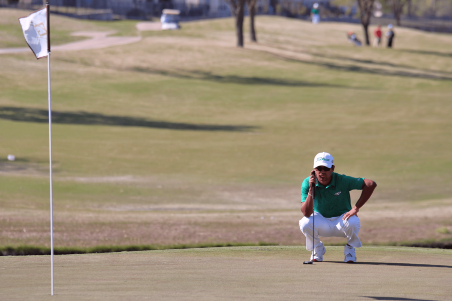 Senior Marco Punzo surveys the putting green during his round. The Eagle golf teams competed in the district rounds April 1-2.  Punzo advanced to play in the regional tournament on  the Cottonwood Creek Golf Course in Waco on April 22-23.
