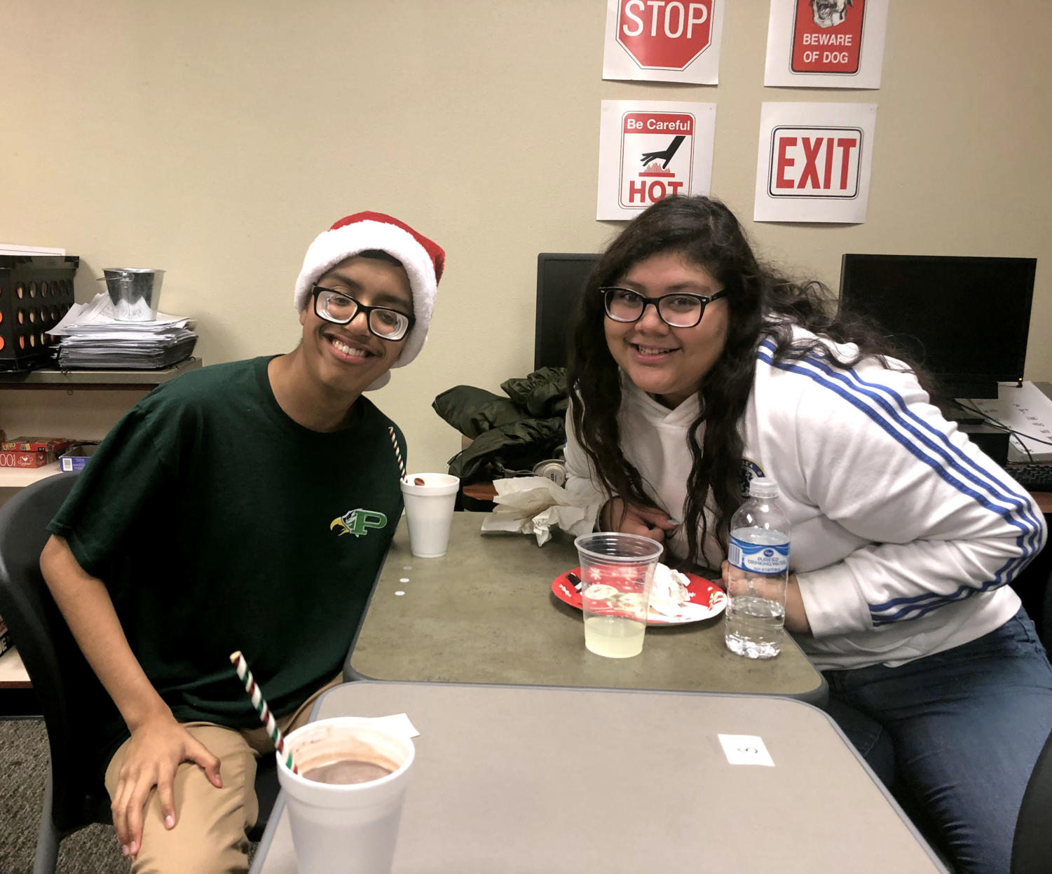 """Two buddies, Antonio Servin and Chelsea Monterrosa, enjoy the annual Best Buddies holiday party. This is the organization's first year at Prosper. """"The fundraising will go towards keeping our chapter afloat,"""" treasurer and sophomore Morgan Begley said. """"It will go towards regional offices, and allow all parts of the organization to keep working."""""""
