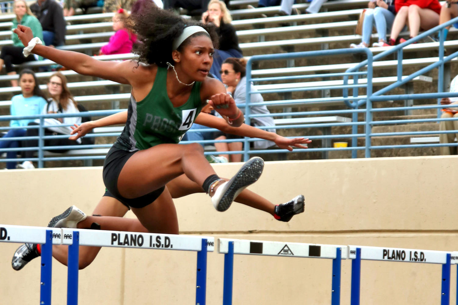 Senior Kennedy Adams leaps over a hurdle while competing. Adams and other athletes competed at Plano ISD on April 3. Adams advanced to the finals in the hurdle event that took place April 4.