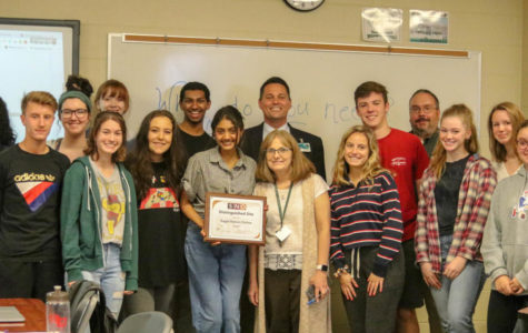 Eagle Nation Online receives SNO Distinguished Site plaque