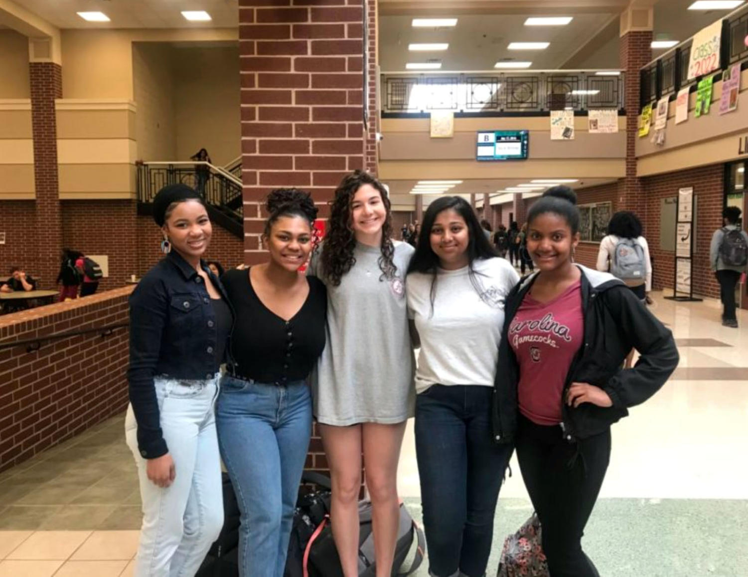 The United Cultural Society club founders gather near the cafeteria. Current club members include Tori Evans, Bronté Funches, Ella Keffer, Nidhi Kamath and Mikayla Brown.  The students have worked with Assistant Principal Dedrick Buckles and the club's sponsor, Audra Claypoole.